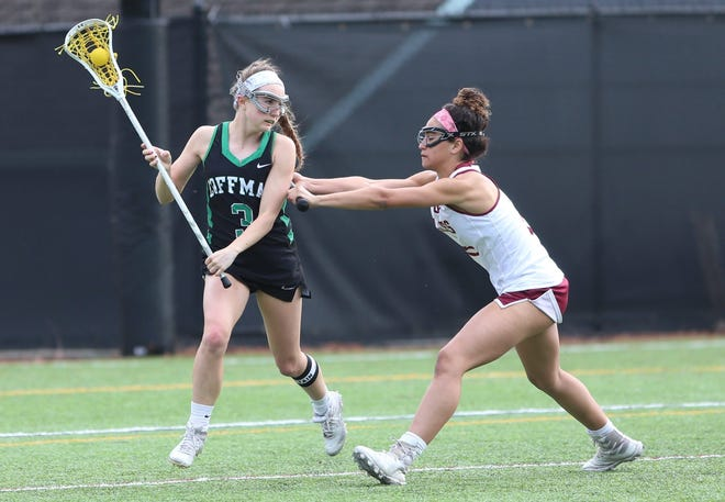 """Coffman midfielder Amanda Bailey is defended by Watterson's  Avery McClain on March 25. Bailey has been called a """"quiet leader"""" by coach Michael Murphy, whose squad was 4-2 overall and 1-1 in the OCC-Central after losing 20-8 to Upper Arlington on April 13."""