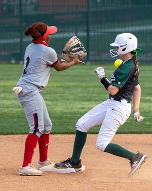 Waxahachie's Kadin Vire motors into second base standing up during Friday night's game at Cedar Hill. The Lady Indians won, 16-10.