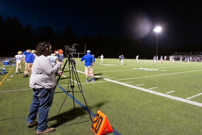 A videographer from Sudbury TV live streams the varsity football game between Lincoln-Sudbury and Acton-Boxborough at Myers Field, April 9, 2021.