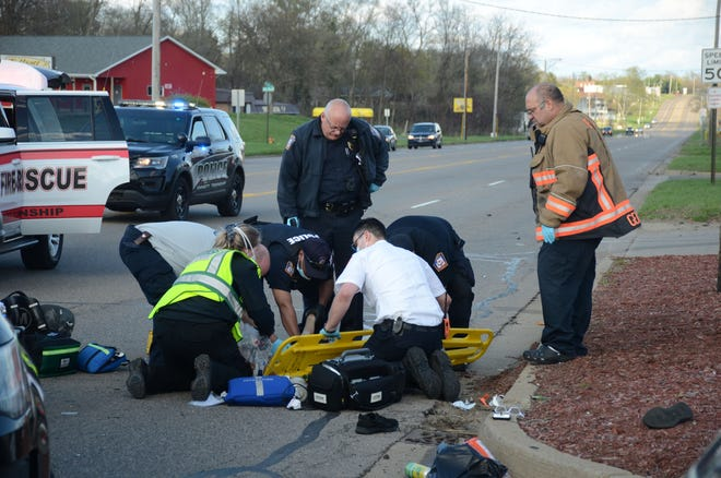 First responders prepare to take Ariq Burks to the hospital Monday afternoon.
