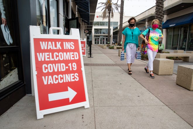 Signs direct the way to the Corpus Christi-Nueces County Public Health District's latest COVID-19 vaccine clinic at La Palmera mall on Tuesday, April 13, 2021.