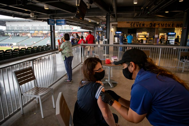 The Corpus Christi-Nueces County Public Health District administers COVID-19 vaccines during a baseball game at Whataburger Field on Monday, April 12, 2021.
