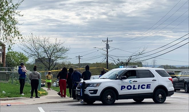 Residents are waiting at the top of hill where Hawaiian Terrace meets Colerain Avenue. Cincinnati police have blocked off all of Hawaiian Terrace following a shooting Tuesday morning. Police say a possible suspect is inside one of the apartments. The CPD mobile command unit just arrived.