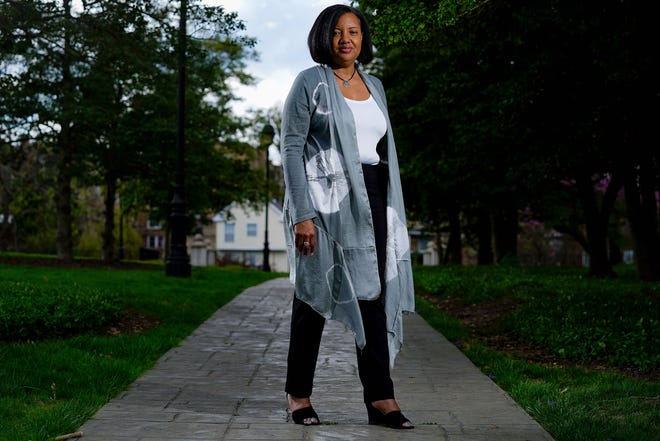 Monica Mitchell, Ph.D., a pediatric psychologist at Cincinnati Children's Hospital, pictured, Friday, April 9, 2021, at Fleischmann Gardens in Avondale, participated in a COVID-19 vaccine study in which she received the placebo. She subsequently contracted the virus.