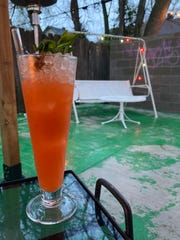 The Karate Kick cocktail served on the patio at The Bartender's Handshake