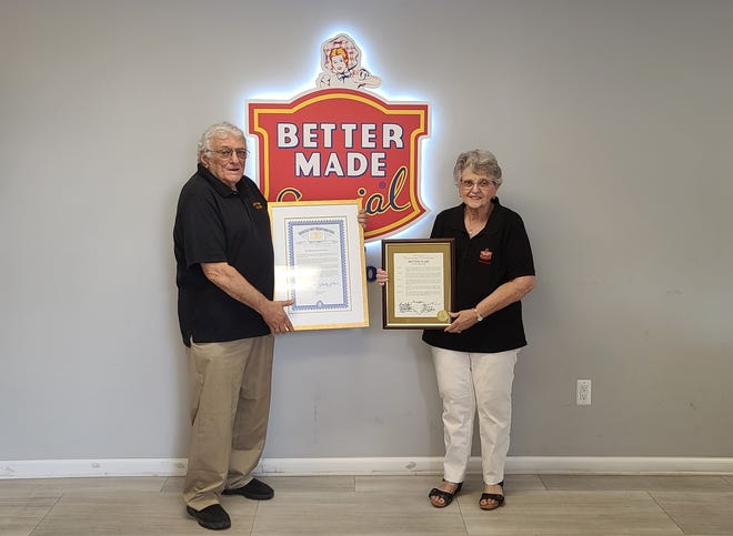 Sam Cipriano and Cathy Gusmano (nee Cipriano) They are each holding proclamations commemorating Better Made's 90th anniversary.