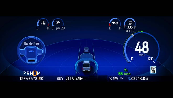 """With BlueCruise drive assist engaged, the instrument display in a Ford F-150 glows blue with self-driving icons like a steering wheel and vehicle """"halo."""""""