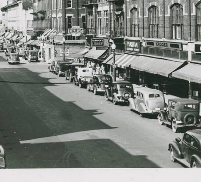 A row of parked cars fills Front Street in Fremont in the 1940s.
