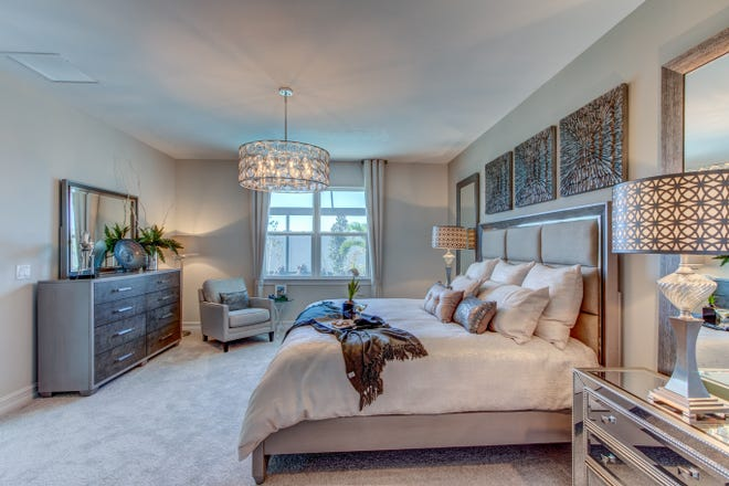 The master bedroom features a king sized bed and room for extra-large night tables, a sitting area and an eight-drawer dresser.