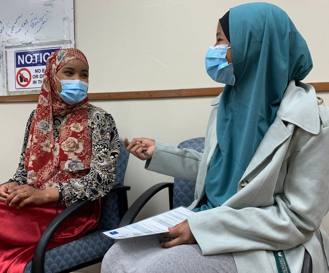 Habon Muhamed, left, and Habibo Hamari, right, chat on Sunday, April 11 at the mobile vaccine clinic set up at the Green Bay area mosque. Muhamed received the vaccine, and Hamari was an interpreter for the clinic.
