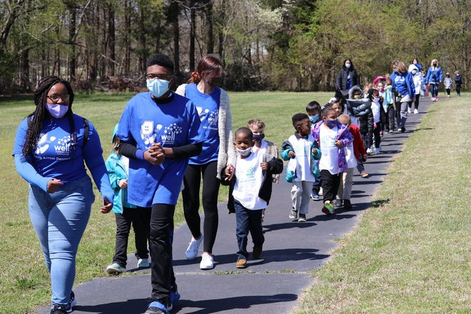 Denmark Elementary dedicated its walking trail to two former students Dallas Weddle and Serenity Wilkes who faced – and overcame – their health challenges.  Serenity and Dallas, now West Bemis Middle School students, lead the current Denmark Elementary students on the walking trail.