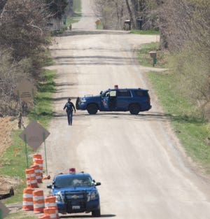 Michigan State Police search the area where a suspect was shot near Milett Road in Howell Township Tuesday, April 13, 2021.
