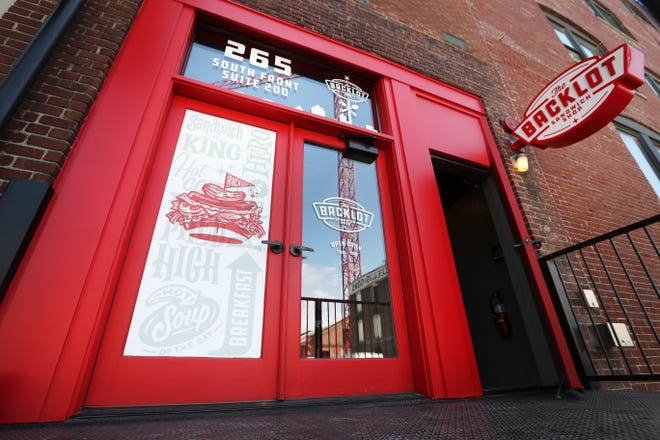 The red door entrance to Backlot Sandwich Shop off Front Street downtown Tuesday, April 13, 2021.