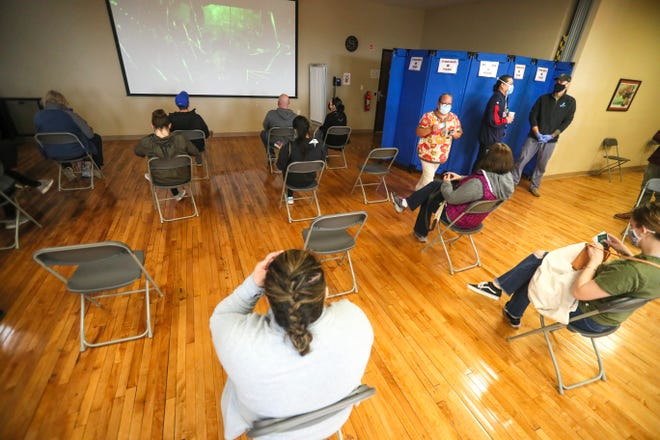 Jessica Martinez, a community health worker, speaks to those about safety practices even after receiving the COVID-19 vaccine Tuesday, April 13, 2021, at Gerald Ignace Indian Health Center in Milwaukee.
