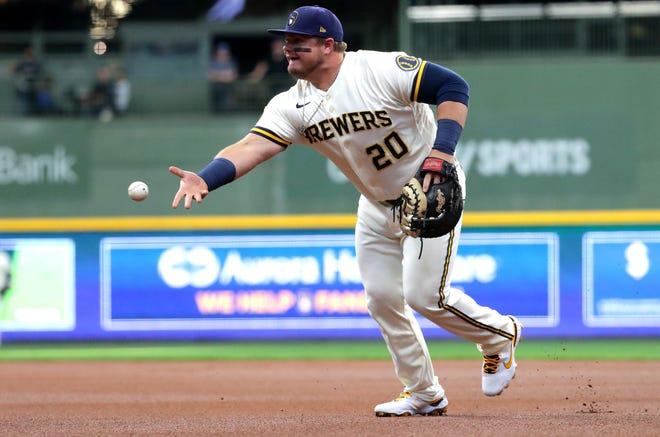 First baseman Daniel Vogelbach tosses the ball to first to retire Cubs center fielder Ian Happ.