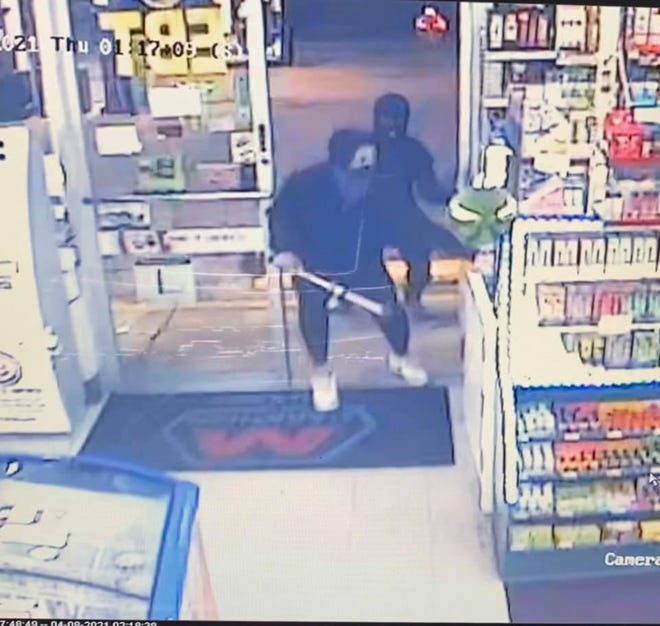 Two bandits who attacked a clerk with a baseball bat entered the Yorktown Food Mart, 9021 W. Smith St., between 1 and 2 a.m. on Thursday, April 8.