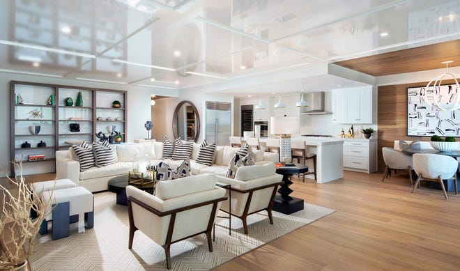 The open-concept floor plans allow the living, dining and kitchen areas to spill out onto the expansive lanai.