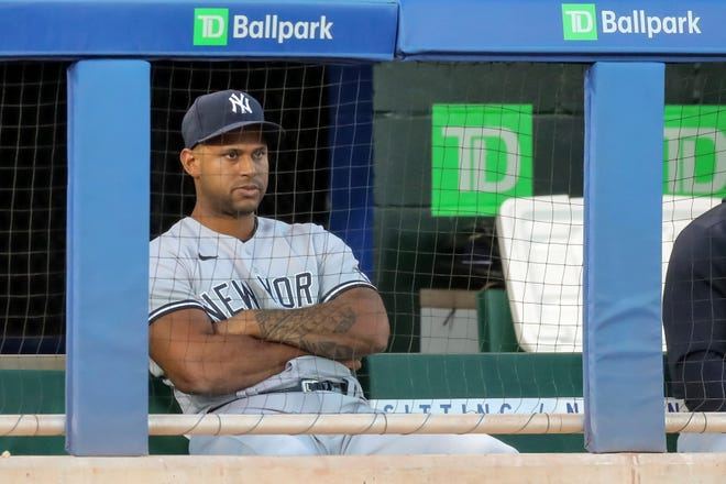 New York Yankees' Aaron Hicks watches the second inning of a baseball game against the Toronto Blue Jays, Monday, April 12, 2021, in Dunedin, Fla. Hicks asked to be removed from the lineup in response to a police shooting in Minneapolis. (AP Photo/Mike Carlson)
