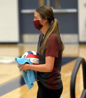 Freshman Erin Turner is doing her part to keep athletes safe during Deming High School sporting events. Turner was with a group of students who kept the volleyballs sanitized during play. She would wipe down the volleyballs that were rotated into play. DHS administration and staff are taking every measure available to keep student-athletes safe during the COVID-19 pandemic.