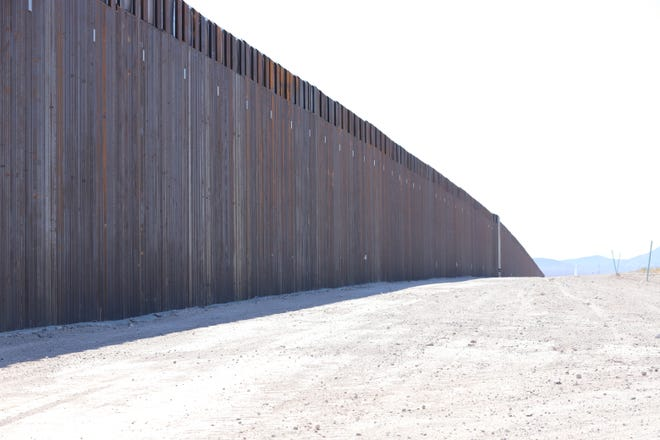 A section of slatted steel bollard border barrier sits on the U.S.-Mexico border in Luna County, New Mexico on Monday, April 12, 2021.