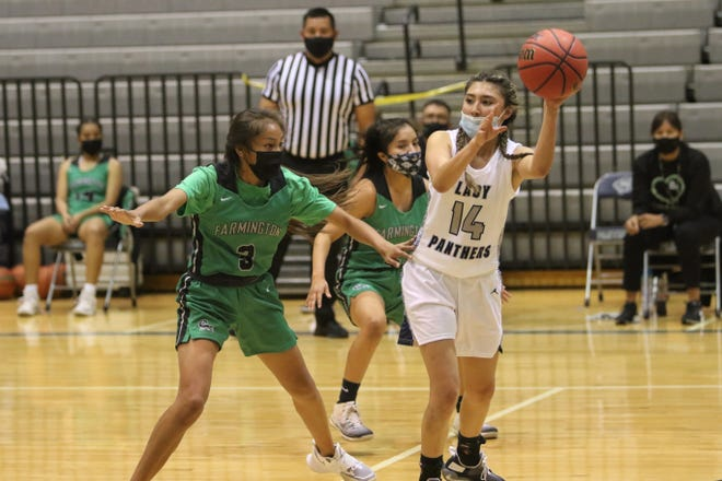 Piedra Vista's Lexi Mitchell looks to pass the ball down the left side against Farmington's Kamalani Anitielu (3) on Monday, April 12, 2021, at Jerry A. Conner Fieldhouse in Farmington.