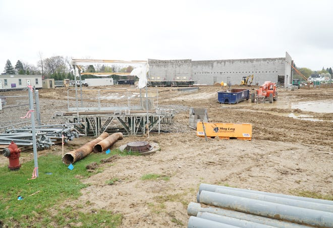 The new Szott Jeep dealership begins to take shape at the Lyon Crossing development in New Hudson.