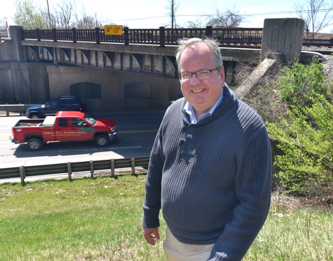 Plymouth Township Supervisor Kurt Heise stands near the Ann Arbor Road railroad overpass west of Haggerty on April 13, 2021. The 80 year-old bridge is slated to be replaced soon.