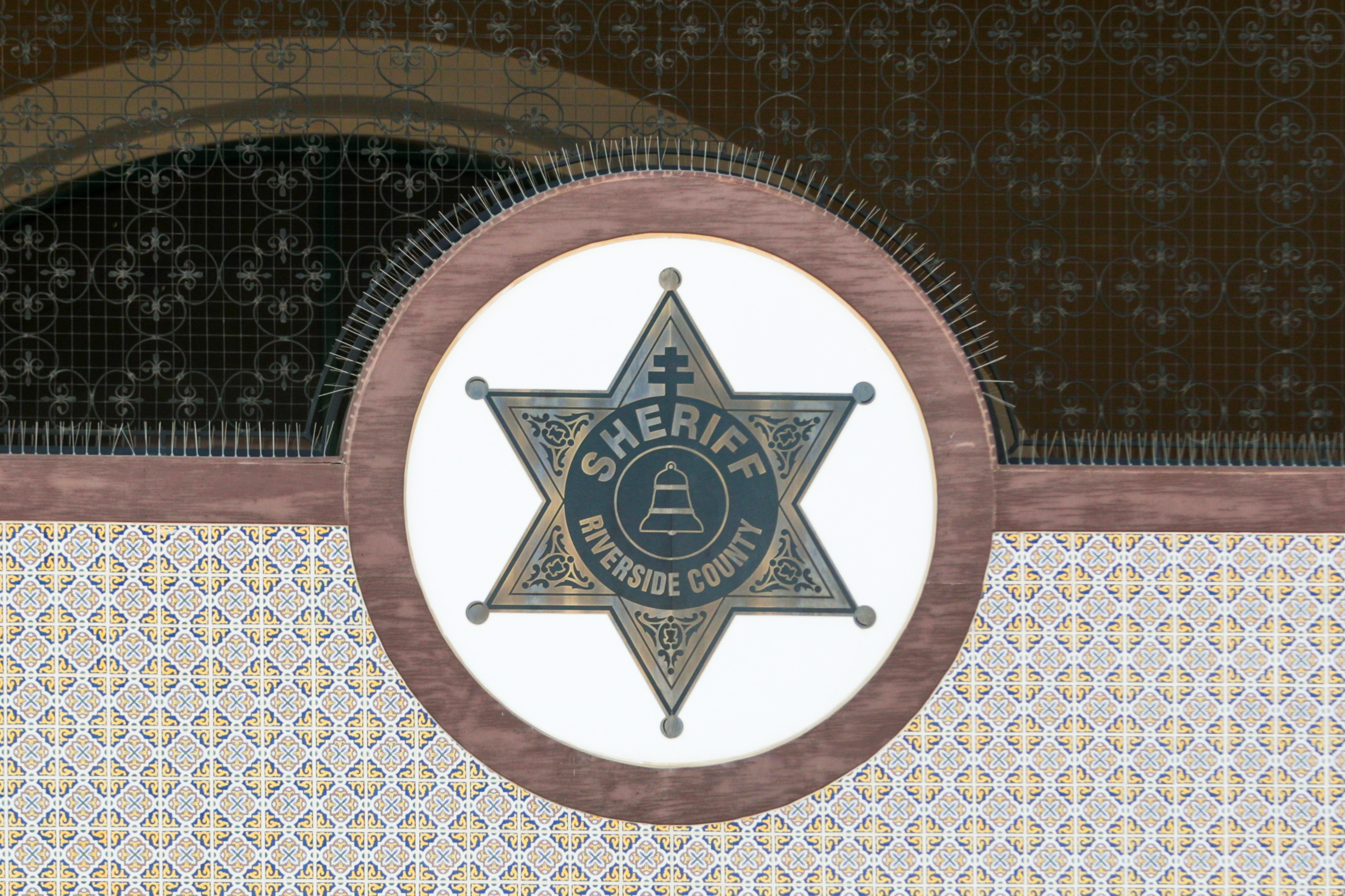 A Riverside County Sheriff's emblem sits on the Thermal Sheriff's Station building at 86625 Airport Blvd. in Thermal.