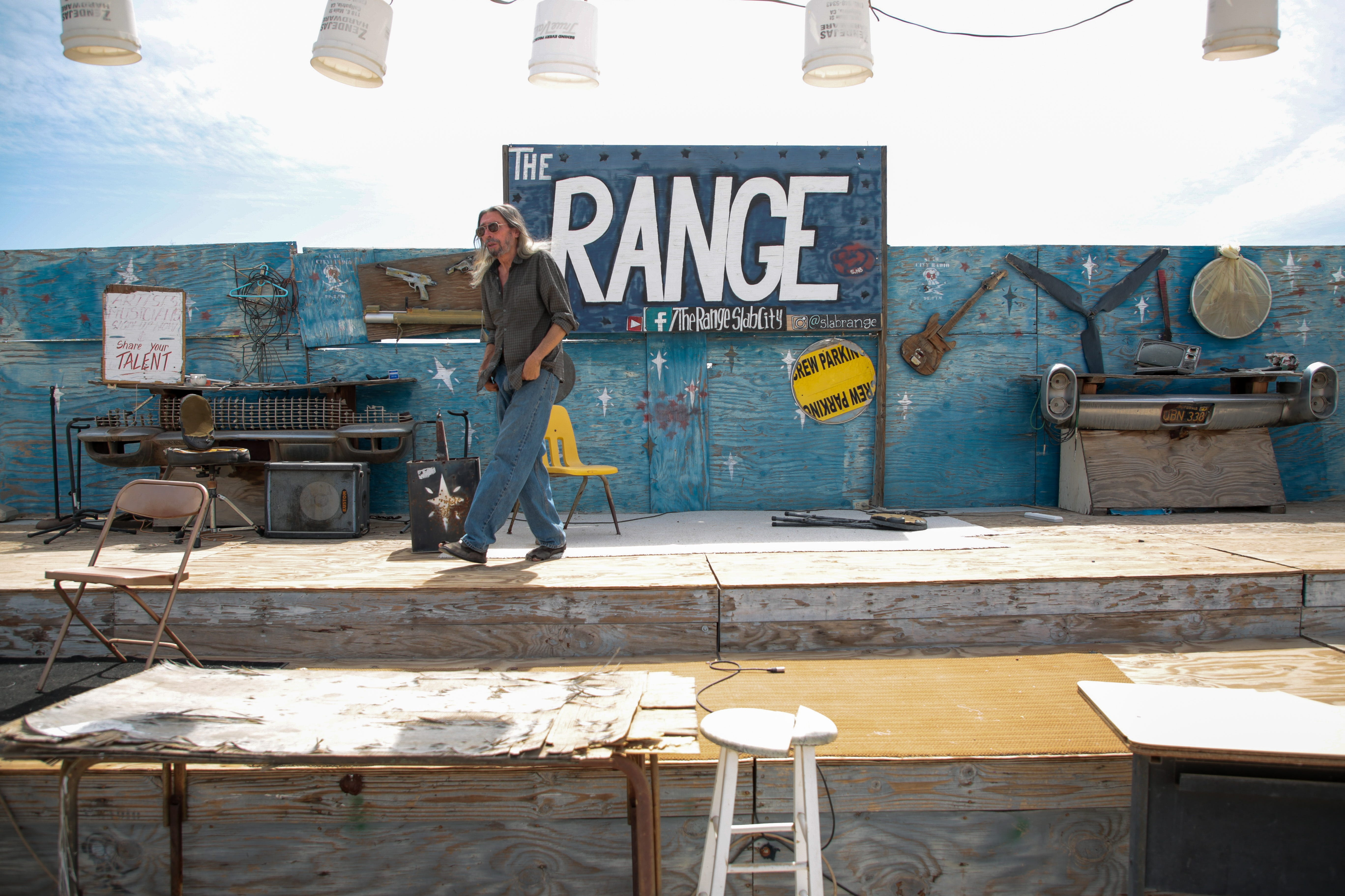Carlos Gonzales walks on the stage at The Range in Slab City, Calif., on Monday, April 5, 2021.