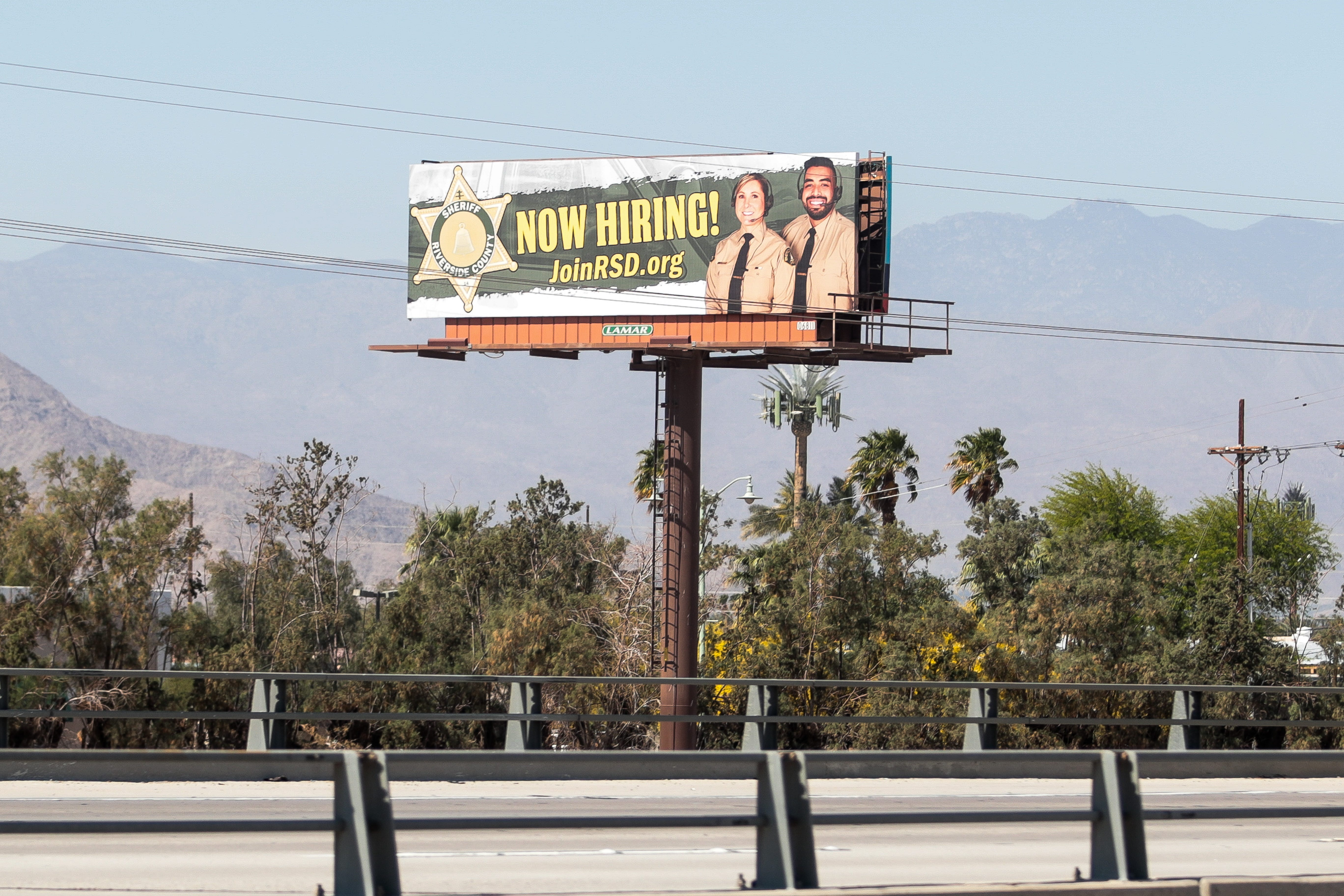 A billboard advertising jobs with the Riverside County Sheriff's Department sits off Interstate 10 near Thermal in 2021.