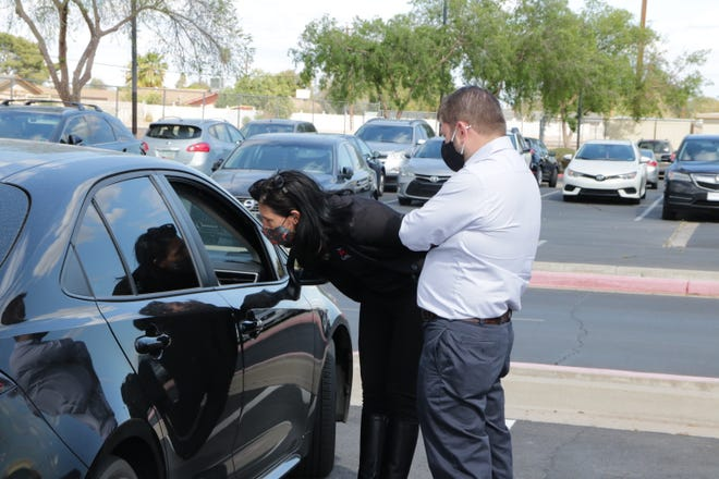 U.S. Rep. Ruben Gallego, D-Ariz., attends a Federal Application for Student Aid drive-in event at Maryvale High School on March 24, 2021.