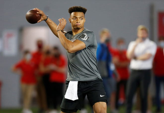 FILE - Ohio State quarterback Justin Fields throws during an NFL Pro Day at Ohio State University in Columbus, Ohio, in this Tuesday, March 30, 2021, file photo. The Division I Council meets Wednesday and Thursday, April 14-15, and at the top of the agenda — at least in terms of importance — is voting on a proposal that would grant all college athletes the right to transfer one time as undergraduates without sitting out season of competition. Some high-profile players such as quarterback Justin Fields, who transferred from Georgia to Ohio State in 2019, were granted waivers by the NCAA and it created an expectation that all players would be cleared to play right away. (AP Photo/Paul Vernon, File)