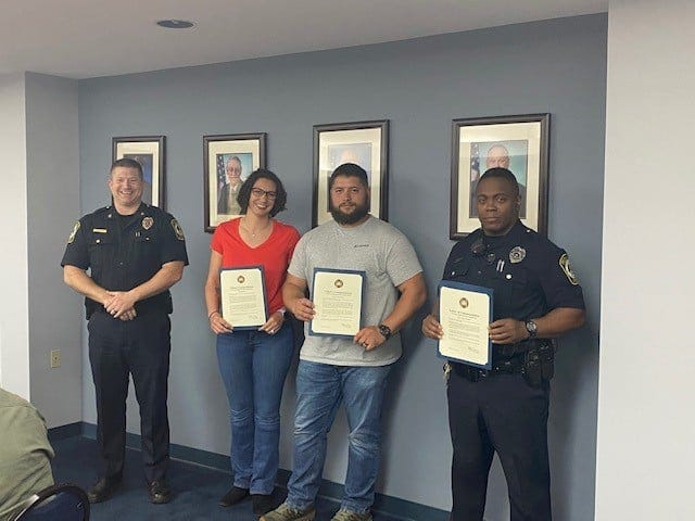 York Area Regional Police Chief Tim Damon gave paramedic Meagan Fatland, and officers Jeremy Fatland and Mitchell Darius letters of commendation during a meeting. April 13, 2021.