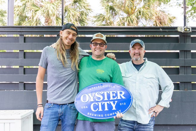 Clayton Mathis, Oyster City's Head Brewer and General Manager, confirmed Apalachicola brewery would be taking over the former GrassLands Brewing building located at 603 W. Gaines St. Pictured from left: Oyster City co-owner Alexi Sekmakas, Oyster City GM Clayton Mathis and co-owner Darin Phillips.