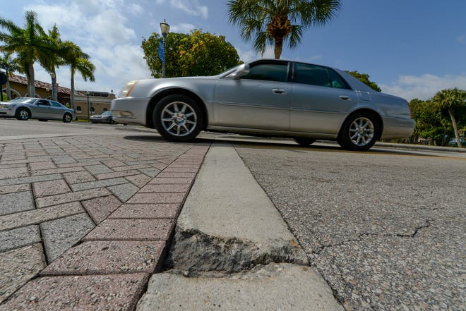 Damaged walkways and cracks in the pavement are seen at the intersection of North 8th Street and Avenue D, on Monday, April 12, 2021, in Fort Pierce. The City of Fort Pierce wants to spend nearly $1 million on road improvements and landscaping from U.S. 1 to North 29th Street.