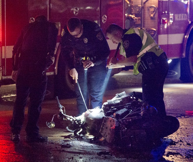 Emergency crews respond to a report of a motorcycle accident on Maurine Street Monday night.