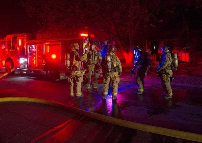 Wichita Falls Firefighters respond to a house fire Monday night on N Seventh Street.