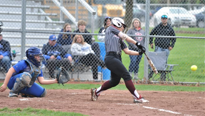 John Glenn's Hannah Bendle hits the ball against Philo in a game earlier this season. Bendle was one of four Muskies to make the Division II first team for East District Softball.