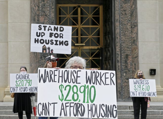 Advocates for low-wage workers demonstrated at City Hall in downtown Columbus on Thursday, May 28, 2020, calling for more affordable housing.