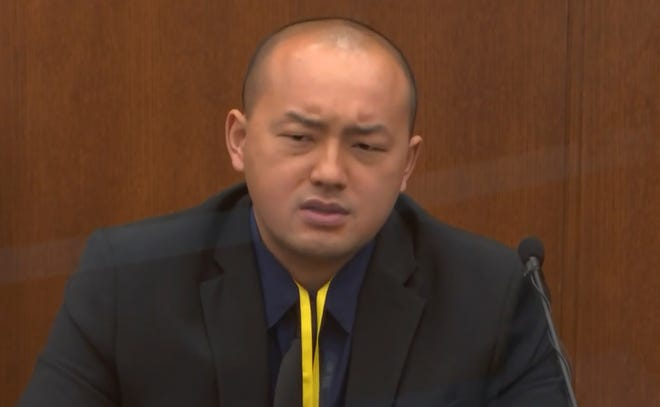 In this image from video, Minneapolis Park Police Officer Peter Chang testifies as Hennepin County Judge Peter Cahill presides, Tuesday, April 13, 2021, in the trial of former Minneapolis police Officer Derek Chauvin at the Hennepin County Courthouse in Minneapolis, Minn.  Chauvin is charged in the May 25, 2020 death of George Floyd.