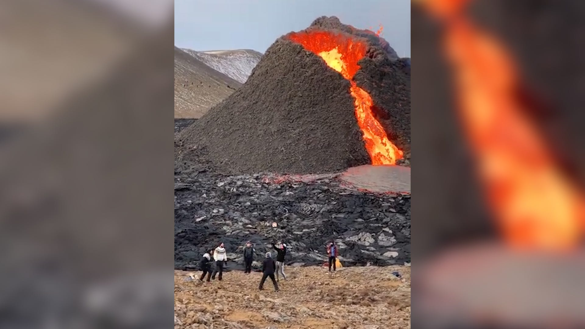 Volcano erupts as friends play volleyball