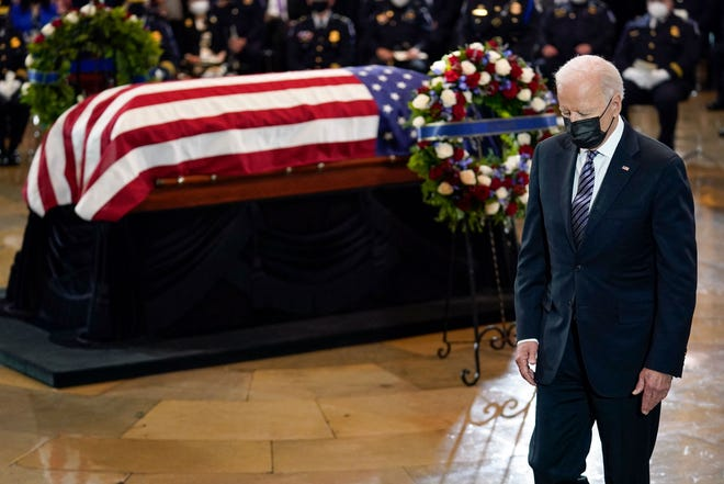 "President Joe Biden walks from the podium after speaking during a ceremony to honor slain U.S. Capitol Police Officer William ""Billy"" Evans as he lies in honor at the Capitol on Tuesday."