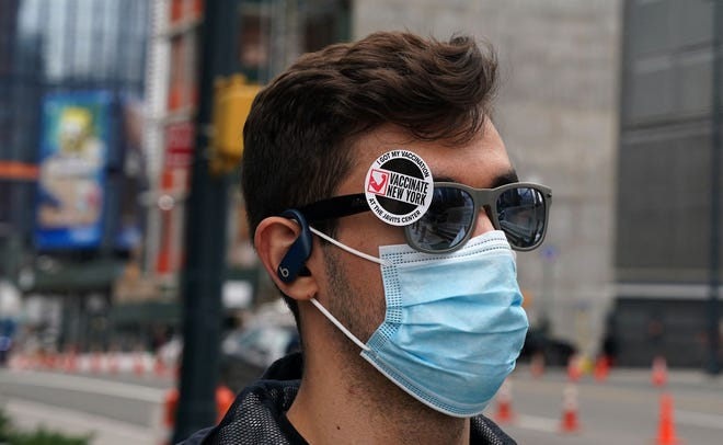 A man leaves after receiving his vaccine at the Javits Center Covid-19 vaccination center on April 13, 2021 in New York.