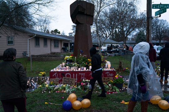 Community members mourn and pay their respects April 12, the day after Daunte Wright was fatally shot by police in Brooklyn Center, Minn.