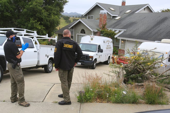 Investigators with the San Luis Obispo County Sheriff Department returned to the house of Reuben Flores Tuesday, April 13, 2021, in Arroyo Grande, Calif. The backyard was marked with crime scene tape as they search for missing Cal Poly student Kristin Smart at the Arroyo Grande house. San Luis Obispo County Sheriff's Office is searching the Arroyo Grande home of Ruben Flores under a warrant. Ruben is the father of Paul Flores, the sole person of interest in missing Cal Poly student Kristin Smart's disappearance. (David Middlecamp/The Tribune (of San Luis Obispo) via AP)