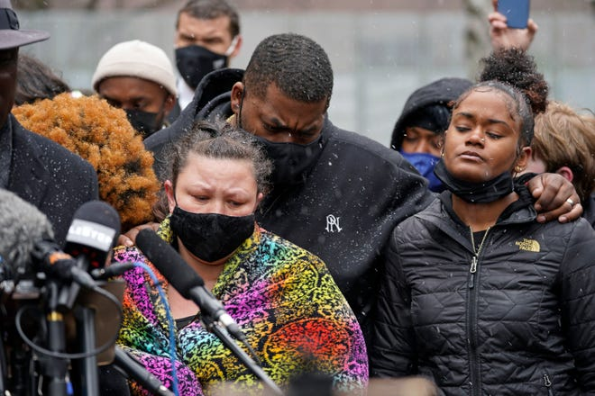 Katie Wright, left, the mother of Daunte Wright, and other family and friends gather during a news conference Tuesday, April 13, 2021, in Minneapolis as family attorney Ben Crump speaks. Daunte Wright, 20, was shot and killed by police Sunday after a traffic stop in Brooklyn Center, Minnesota.