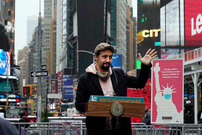Lin-Manuel Miranda delivers his remarks in Times Square after he toured the grand opening of a Broadway COVID-19 vaccination site intended to jump-start the city's entertainment industry, in New York, Monday, April 12, 2021.