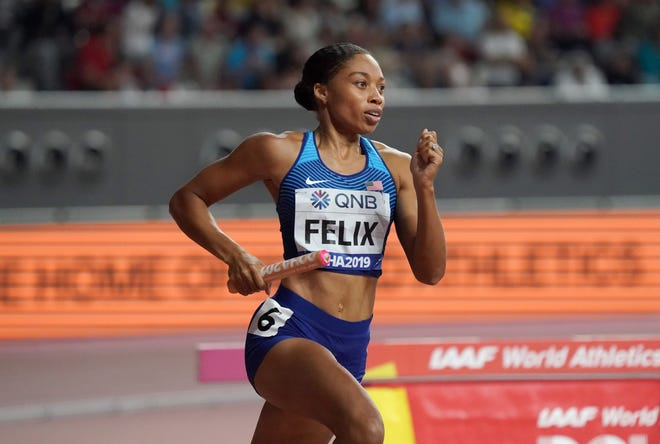 Allyson Felix runs the second leg on the United States women's 4 x 400m relay that won its heat during the IAAF World Athletics Championships in 2019.