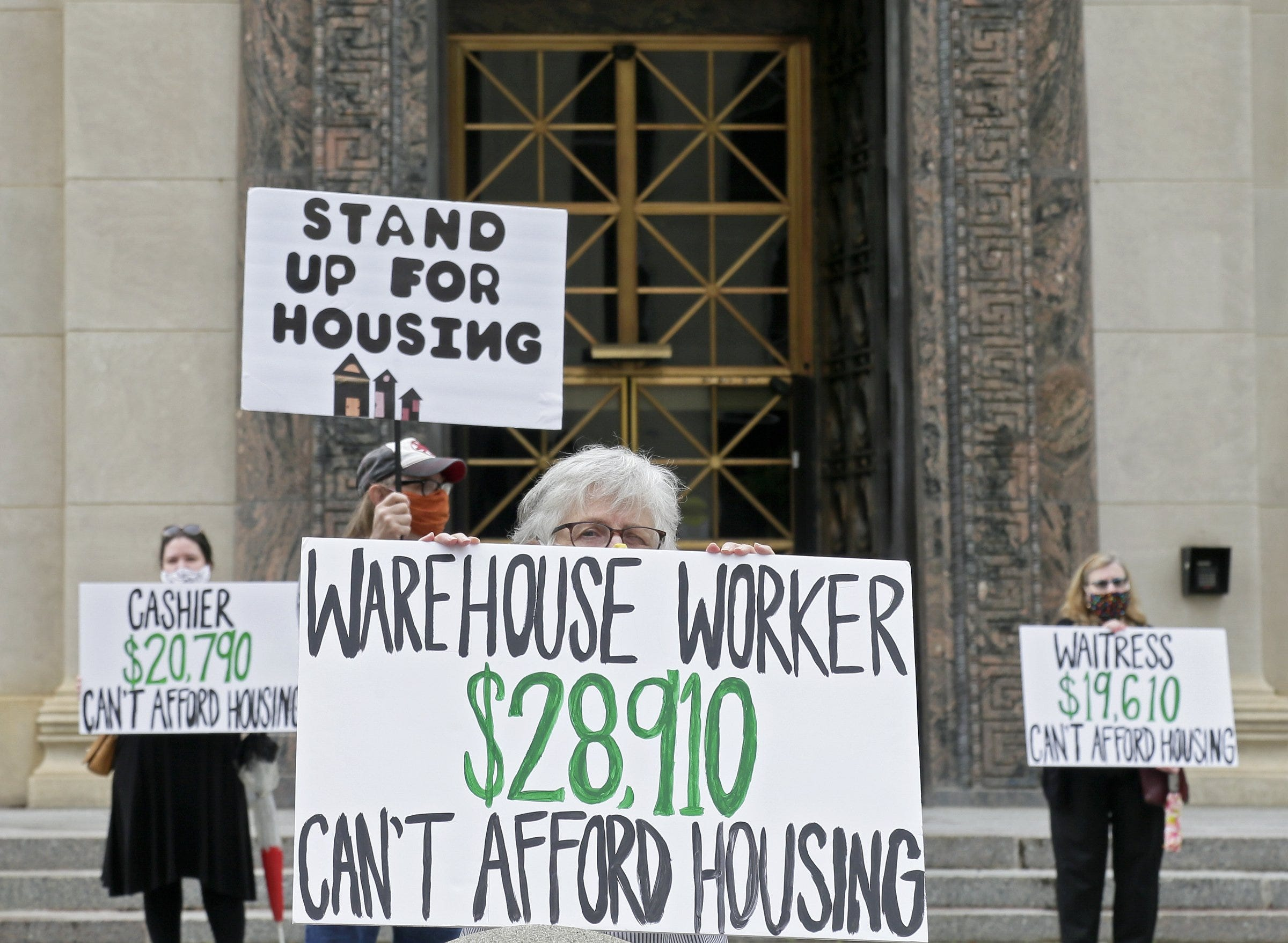 Advocates for low-wage workers demonstrated at City Hall in downtown Columbus on Thursday, May 28, 2020, calling for more affordable housing and assistance for those facing eviction due to the coronavirus pandemic. [Barbara J. Perenic/Dispatch] ORG XMIT: 159890 (Via OlyDrop)
