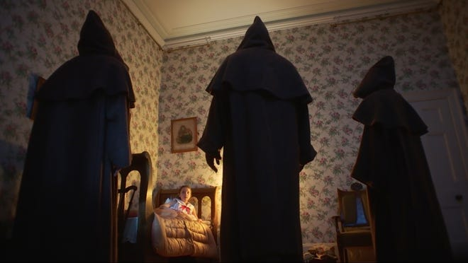 "A young girl (Anya McKenna-Bruce) doesn't know what to do when three creepy hooded figures show up in her room in ""The Banishing."""